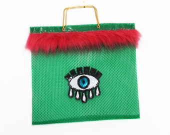 Original bag 60s customized by the brand. Green Color. Made in Spain. Sequin patch.