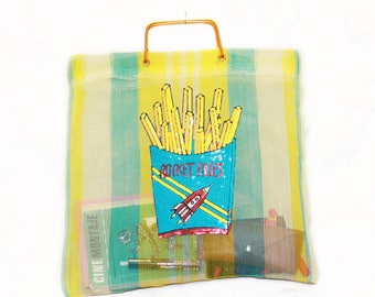 French fries bag. Original 60s bag customized with brand patches. Made in Spain. Golden handles.