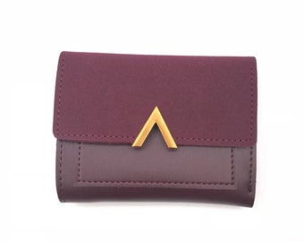 Wallet in faux leather, gold and plum