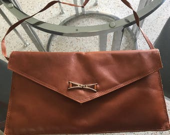 Vintage brown leather handbag with coin purse attachment.
