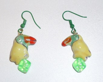 Toucan Play That Game: earrings featuring yellow ceramic toucans perched on green dice