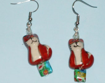 Foxes in the Garden: earrings with ceramic foxes and millefiore glass beads