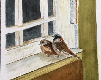 Sparrows on the windowsill