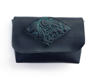Envy Pouch. Vegan quilted faux leather accessory. Unique black purse with freehand quilting, great for bag organization.