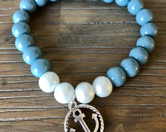Nautical shaped beaded bracelet with silver anchor.