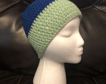 Crocheted green and blue hat.
