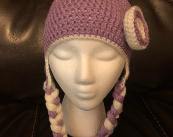 Purple crocheted hat with braids and flower.
