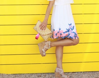 Straw clutch with multi color pompoms and pink ombre tassel