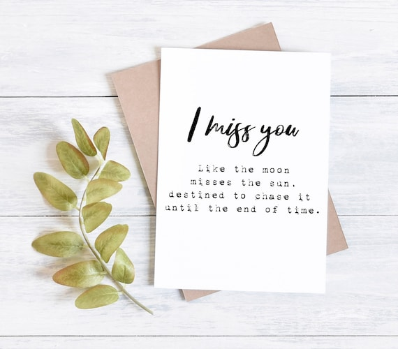 I miss you like the moon misses the sun greetings card