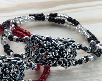 Beautiful Bracelet with Great Flower CentrePiece in Black and 'Silver' Glass Beads on an Elastic Cord