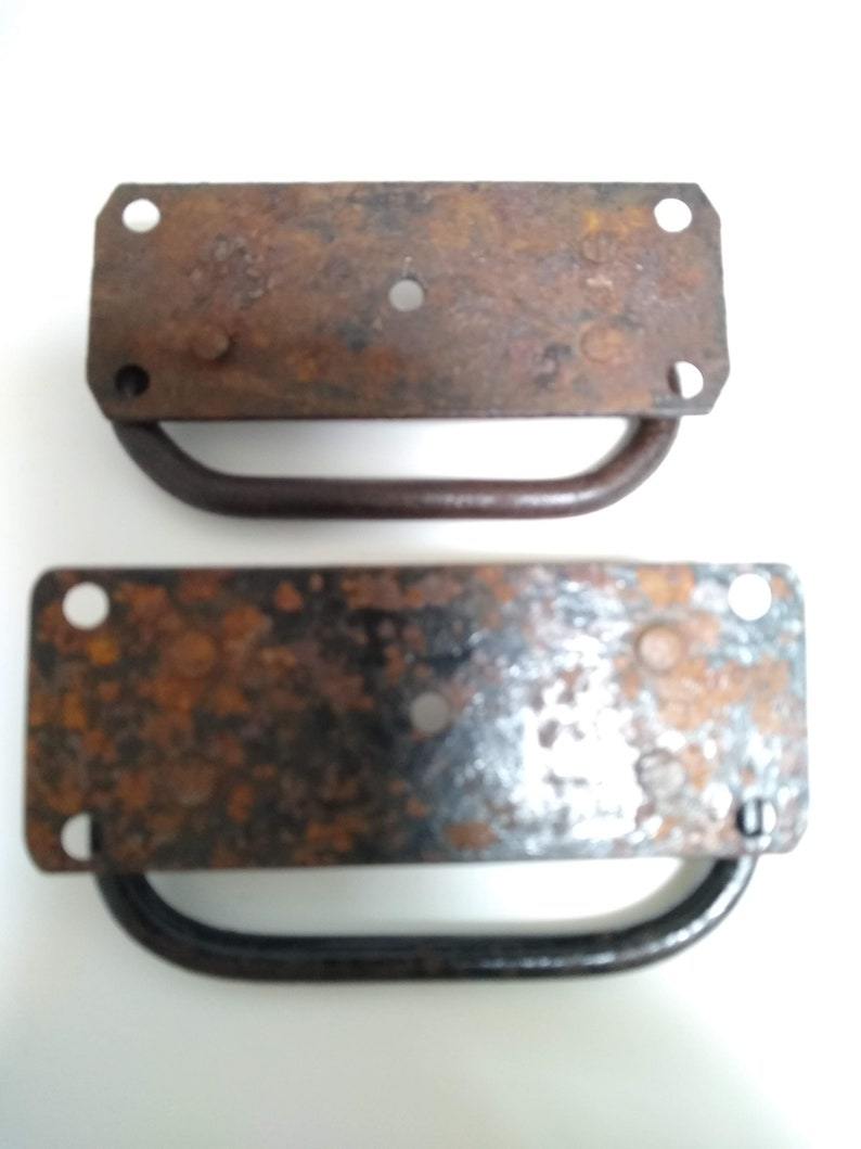 Lot of two vintage hand forged iron or steel trunk handles