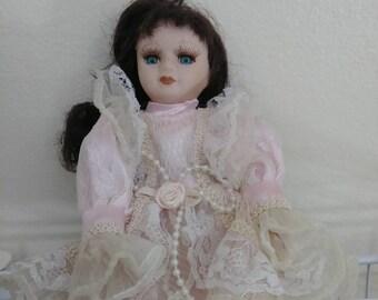 Miniature porcelain doll