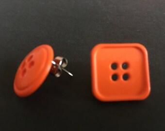 Orange mismatch button stud earrings.