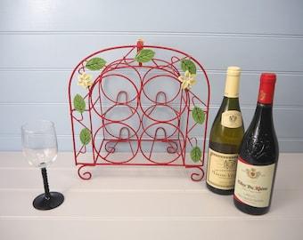Vintage French red bottle holder with leaf detail 1960s Compact retro wire wine rack Mid-century wine bottle basket Kitchen shelf storage