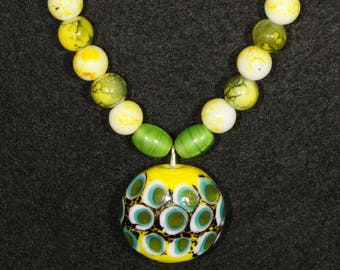 Necklace withYellow and Green Beading, with green faux leather band.