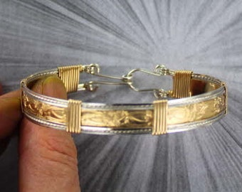 BRACELET  IN  14KT ROLLED GOLD AND STERLING SILVER SIZE 5 TO 9  WIRE WRAPPED