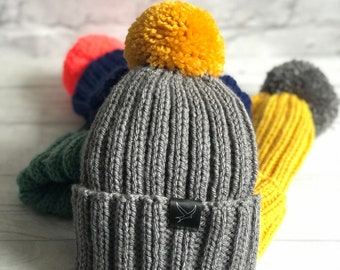Grey wool adult hand knitted hat with mustard pom pom