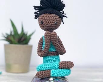Black yogi with turquoise yoga wear, posable with yoga mat