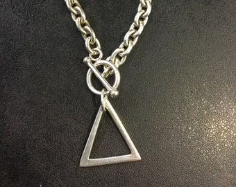 Silver bracelet with triangle drop