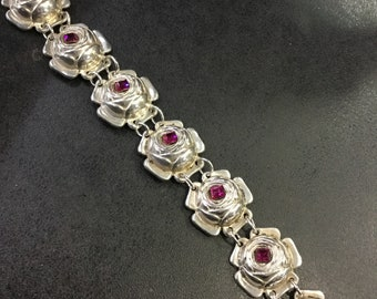 Silver roses bracelet with pink stones