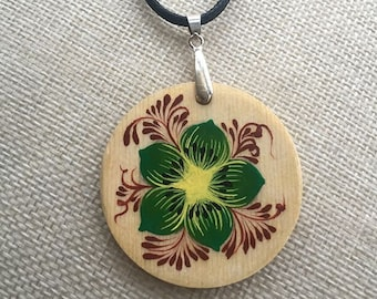 Round wooden pendant on leather necklace