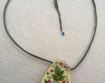 Wooden pendant on a leather necklace