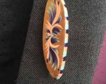 Small wooden brooch