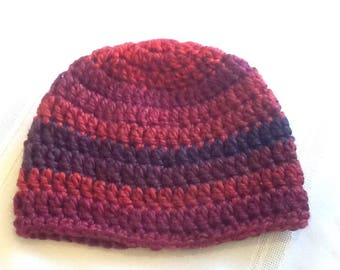 Crocheted baby hat variegated shades of red