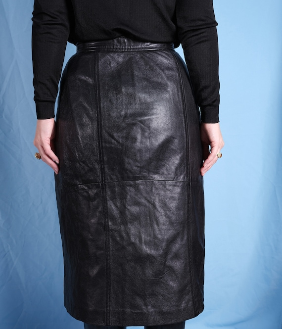 Vintage Black pencil skirt with golden thread embroidery by NEW LOOK High waist Midi Pencil skirt split on the back. Size 12 Made in U.K