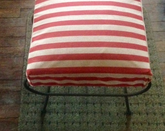 Vintage Footstool with magazine rack.  Red Stripes and iron legs.