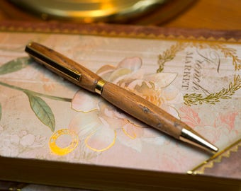 Hand crafter pen made of Wormy Chestnut, a totally extent wood.