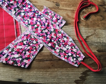Pink floral weightlifting wrist wraps
