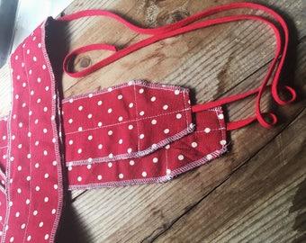 Red polka dot weightlifting wrist wraps