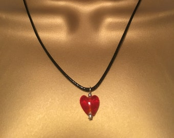 Red love heart glass pendant on a wax black cotton necklace
