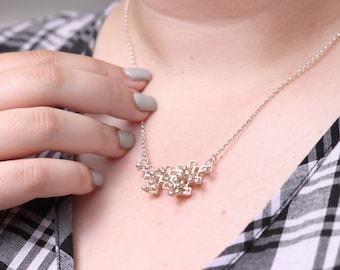 Kinetic pendant, interactive fidget jewellery, large polished silver, style 1.