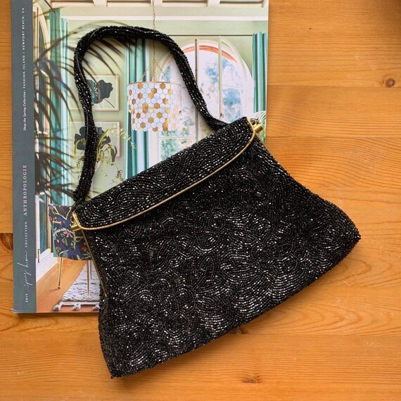 Inticately beaded black purse 50s