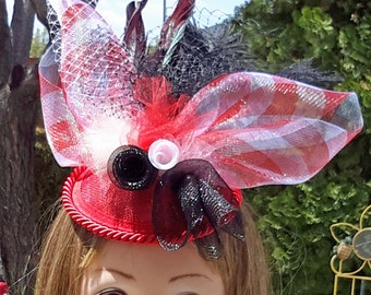 Fascinator Hat.  Red sinamay base with trim, red and white checkered crinoline, feathers.