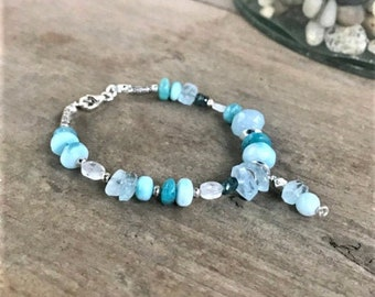 Larimar smooth rondelles, moonstone ovals, freeform aquamarine beads, Karen Hill mix, tiny kyanite beaded bracelet, sterling mix, charm