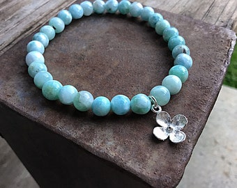 Genuine 6mm ocean blue larimar beaded bracelet with a sterling silver flower charm