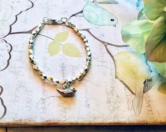 Karen Hill Tribe faceted hexagon beaded bracelet with Karen Hill Tribe bird charm