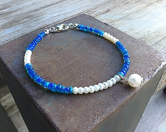 Blue fire opal and freshwater pearls tiny beaded bracelet, pearl charm