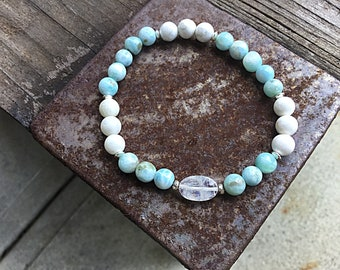Genuine 7mm Dominican larimar bracelet with a rainbow moonstone ovaland 2 tiny Karen Hill Tribe imprint beads, sterling beads