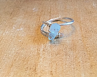 High grade aquamarine ring on textured sterling silver wire, swirling, wrap around, solitaire