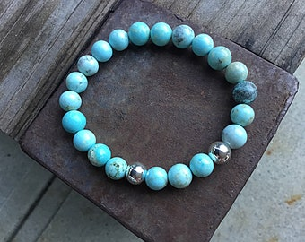 Light green blue turquoise beaded bracelet with 2 silver plated beads, stacking