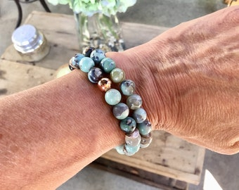 Aqua terra agate, 8mm beaded bracelet, pictured top