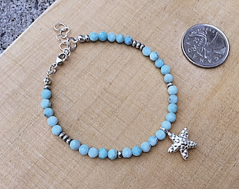 Genuine 4mm ocean blue larimar beaded bracelet with a Karen Hill Tribe starfish charm and tiny imprint seed beads