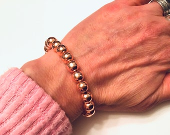 Bright rose gold hematite, heavy, 8mm beaded bracelet