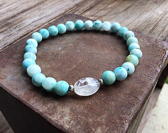 Blue hemimorphite 6mm beaded bracelet with high grade rainbow moonstone oval feature bead and 2 Karen Hill Tribe silver imprint seed beads