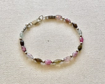 Watermelon tourmaline oval marquise beads and Karen Hill Tribe silver imprint tube beads with silver spacers bracelet