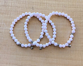 Pink Mangano  calcite 6mm beaded bracelet with 2 Karen Hill Tribe imprint beads and a sterling heart charm